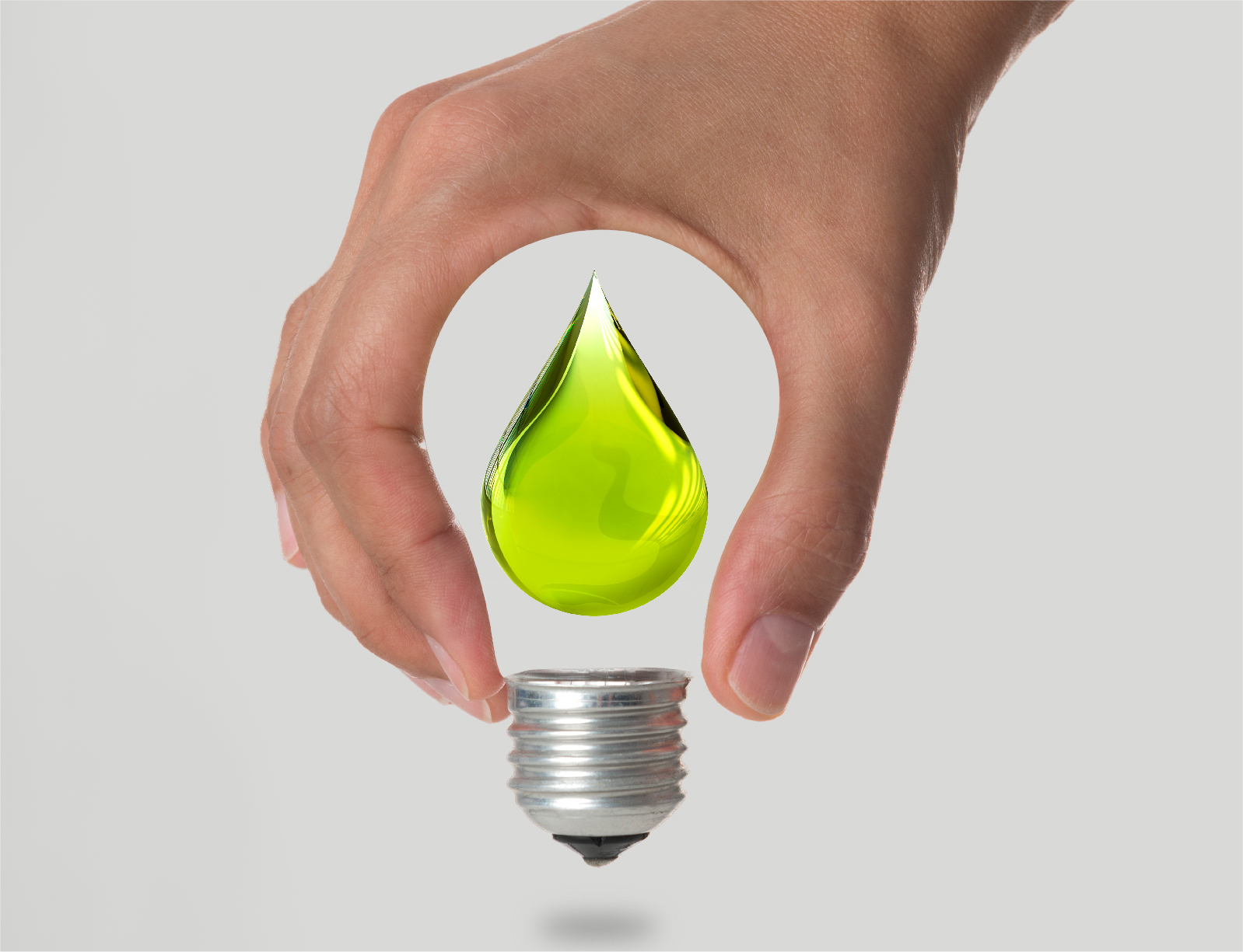 hand holding green fuel style light bulb
